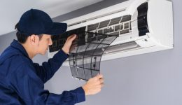 technician-service-removing-air-filter-air-conditioner-cleaning_35076-3617